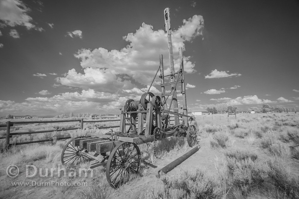 What appears to be a drilling rig in the Fort Rock homestead. In 1988 the Fort Rock Valley Historical Society opened the Fort Rock Homestead Village Museum which preserves and protects homestead-era structures. The buildings were moved from their original locations to the museum site just west of the town of Fort Rock., Oregon. © Michael Durham