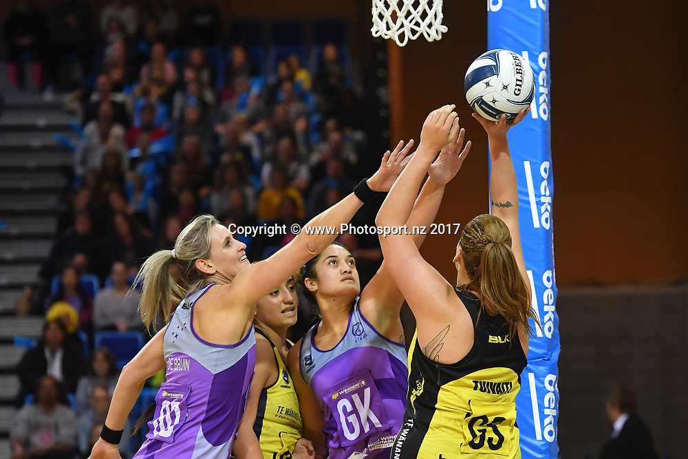Pulse's Catherine Tuivaiti (R takes a shot at goal with Star's Leana De Bruin (L) and Sulu Fitzpatrick during the ANZ Premiership netball match between the Pulse and Northern Stars at the Te Rauparaha Arena on Wednesday the 14th of June 2017. Copyright Photo by Marty Melville / www.Photosport.nz