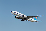 LOS ANGELES, CALIFORNIA, USA - JANUARY 28, 2013 - China Southern Airlines Boeing 777 takes off from Los Angeles Airport on January 28, 2013. It has the most powerful jet engines in commercial service.