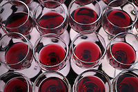 20 September 2012: Wine glasses filled with red wine for a fund raiser tasting in Long Beach, CA.