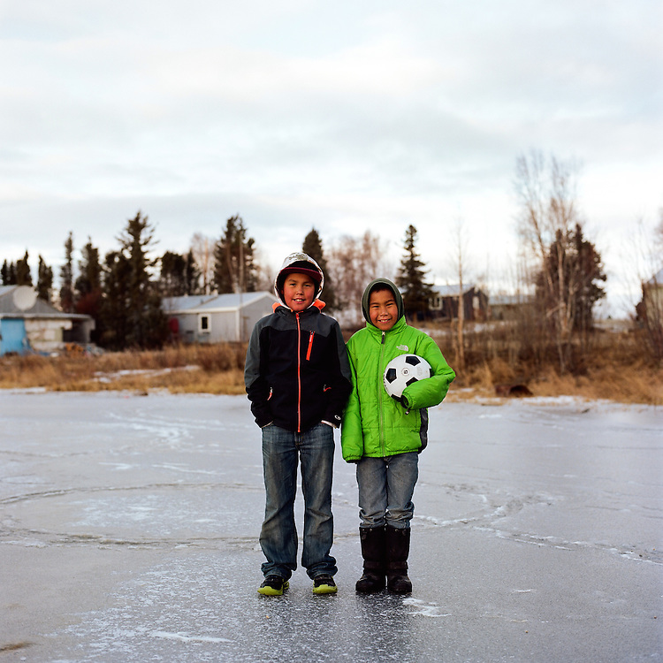 Dominic Cleveland and Dennis Cleveland playing soccer on very thin ice in Shungnak, Alaska. 2015