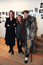 Left to right, ARI ASHLEY, GAZ MAYALL and AMANDA GOVETT at a private view of photographs by Nick Ashley held at the Sladmore Gallery, 32 Bruton Place, London on 13th January 2010.
