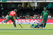 Mosaddek Hossain of Bangladesh survives a run out attempt by Shadab Khan of Pakistan during the ICC Cricket World Cup 2019 match between Pakistan and Bangladesh at Lord's Cricket Ground, St John's Wood, United Kingdom on 5 July 2019.