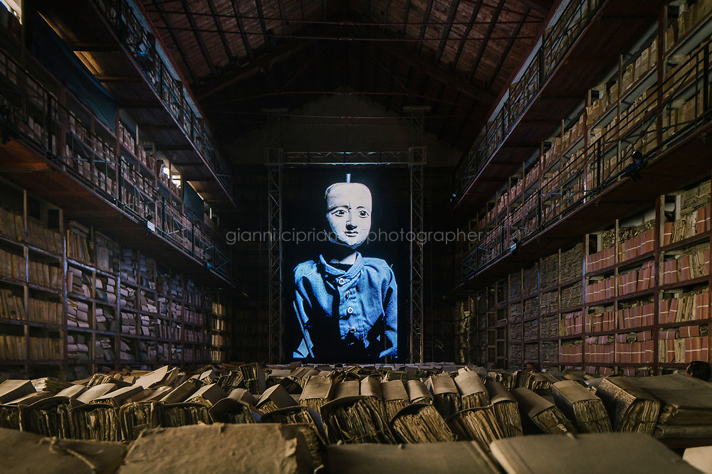 PALERMO, ITALY - 16 JUNE 2018: Site-specific video installation &quot;Protocol no. 90/6&quot; by Masbedo is seen here in the Sala delle Capriate of the Archivio di Stato during Manifesta 12, the European nomadic art biennal, in Palermo, Italy, on June 16th 2018.<br /> <br /> Manifesta is the European Nomadic Biennial, held in a different host city every two years. It is a major international art event, attracting visitors from all over the world. Manifesta was founded in Amsterdam in the early 1990s as a European biennial of contemporary art striving to enhance artistic and cultural exchanges after the end of Cold War. In the next decade, Manifesta will focus on evolving from an art exhibition into an interdisciplinary platform for social change, introducing holistic urban research and legacy-oriented programming as the core of its model.<br /> Manifesta is still run by its original founder, Dutch historian Hedwig Fijen, and managed by a permanent team of international specialists.<br /> <br /> The City of Palermo was important for Manifesta&rsquo;s selection board for its representation of two important themes that identify contemporary Europe: migration and climate change and how these issues impact our cities.