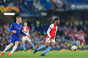Chelsea midfielder Ross Barkley (8) and Slavia Prague midfielder Ibrahim Traore (27) during the Europa League  quarter-final, leg 2 of 2 match between Chelsea and Slavia Prague at Stamford Bridge, London, England on 18 April 2019.