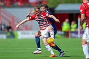 Sam Kelly of Hamilton Academical FC holds off Peter Haring of Heart of Midlothian during the Ladbrokes Scottish Premiership League match between Hamilton Academical FC and Heart of Midlothian FC at New Douglas Park, Hamilton, Scotland on 4 August 2018. Picture by Malcolm Mackenzie.