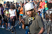 Man with helmet, costumed as constructer. Carnival. Mindelo. Cabo Verde. Africa.