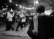 A crowd gathers to watch tango dancers (tanqueros) in Plaza Dorrego, San Telmo.