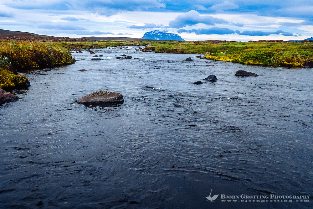 Iceland. River along the road to Askja in the highlands of Iceland. Herdubreid in the background.