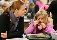 Beth DeBoom (from left) watches as her daughter, Frankie DeBoom, 8, both of Cedar Rapids, dissects an owl pellet in the Creature Feature room at the 11th annual Coe College Playground of Science at Peterson Hall of Science in Cedar Rapids on Thursday, October 24, 2013. Faculty and students from the physics, biology, chemistry, mathematics, computer science, nursing, psychology and ROTC departments provided demonstrations and facilitated hands-on opportunities to show students of all ages that science can be fun.
