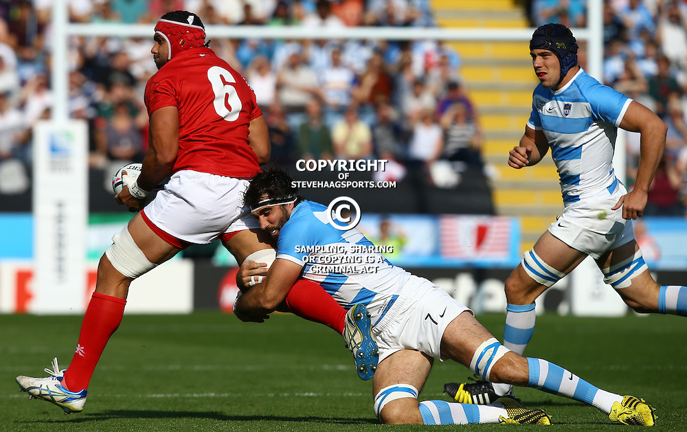 LEICESTER, ENGLAND - OCTOBER 04: Juan Martin Fernandez Lobbe of Argentina looks to tackle Sione Kalamafoni of Tonga during the Rugby World Cup 2015 Pool C match between Argentina and Tonga at Leicester City Stadium on October 04, 2015 in Leicester, England. (Photo by Steve Haag/Gallo Images)