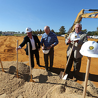 Mayor jason Shelton, from left, Colin Maloney and Mike Smith get ready to break ground Thursday morning for the new Faripark Towers project being built in Fairpark.