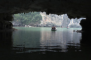 © Licensed to London News Pictures. 31/12/2011. Tourist boats explore the caves at Halong Bay,  Vietnam. Photo credit : Stephen Simpson/LNP