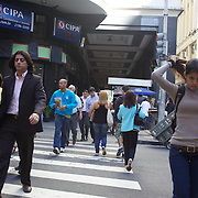 Commuters head for work in the city centre of Rio de Janeiro,  Brazil. 8th July 2010. Photo Tim Clayton..