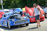 Mike Raupp of Langhorne, Pennsylvania walks past a 1946 Oldsmobile during a car show presented by Bucks County Stangz at the Bucks County Senior Center Saturday August 27, 2016 in Morrisville, Pennsylvania.  (Photo by William Thomas Cain)
