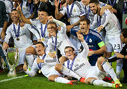 12-08-2014 WAL: UEFA Super Pokal, Real Madrid vs FC Sevilla, Cardiff<br /> Real Madrid's Gareth Bale, Cristiano Ronaldo and Luka Modric celebrate with the trophy after their 2-0 victory over Sevilla<br /> <br /> ***NETHERLANDS ONLY***