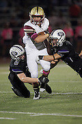 Cedar Ridge defensive players Connor Kaup and Josh Arzola tackle a Rouse runningback Friday at Dragon Stadium.  (LOURDES M SHOAF for Round Rock Leader.)