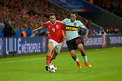 LILLE, FRANCE - Friday, July 1, 2016: Wales' Hal Robson-Kanu and Belgium's Jason Denayer during the UEFA Euro 2016 Championship Quarter-Final match at the Stade Pierre Mauroy. (Pic by David Rawcliffe/Propaganda)