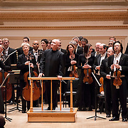 March 7, 2012 - New York, NY : Conductor Christoph Eschenbach, center, and the Boston Symphony Orchestra take a bow after performing in the Isaac Stern Auditorium at Carnegie Hall on Wednesday night. CREDIT: Karsten Moran for The New York Times