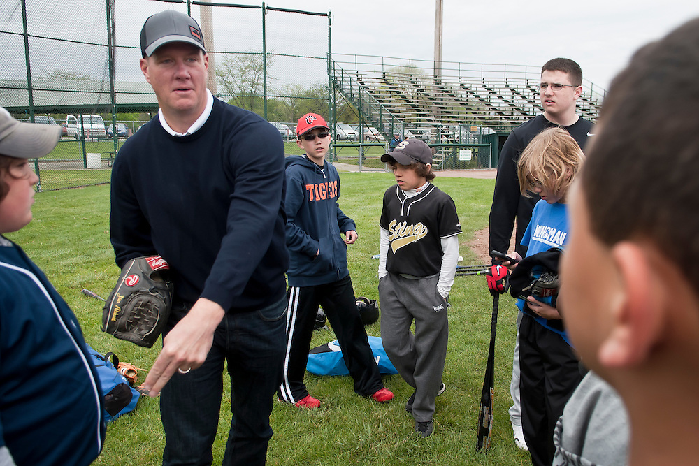 Lathan Goumas | MLive.com..May 5, 2012 - Former professional baseball player Jim Abbott demonstrates how he throws a baseball while talking with a group of kids during a Pitch Hit & Run competition sponsored by the Boys & Girls Club of Greater Flint on Saturday at Broome Park in Flint, Mich. Abbott played for Flint Central High School and the University of Michigan before playing professional baseball.