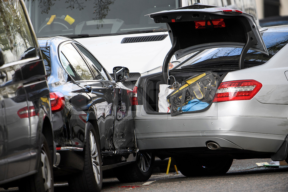 © Licensed to London News Pictures. 13/04/2019. London, UK. Damage to the Ambassadors car (left), caused by another vehicle (right) at the scene in Holland Park after shots were fired near the Ukrainian embassy. Photo credit: Ben Cawthra/LNP