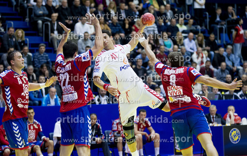 Mateusz Zaremba of Poland vs Bojan Beljanski of Serbia and Nikola Manojlovic of Serbia during handball match between Poland and Serbia in Preliminary Round of 10th EHF European Handball Championship Serbia 2012, on January 15, 2012 in Arena Pionir, Belgrade, Serbia. Serbia defeated Poland 22-18. (Photo By Vid Ponikvar / Sportida.com)