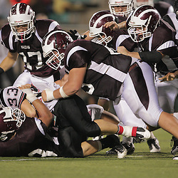 14 November 2008: St. Thomas Aquinas DL Dion Patterson (#53) and St. Thomas Aquinas DL Russell Ribando  (#55) combine on a tackle during the St. Thomas Falcons 47-28 playoff victory over the Welch Greyhounds at Strawberry Stadium in Hammond, LA.