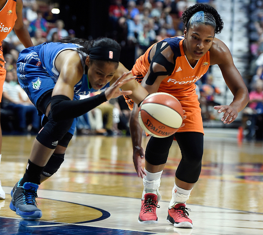 7/7/16 :: SPORTS :: GRIFFEN :: Connecticut's Alyssa Thomas, right, and Minnesota's Maya Moore chase a loose ball in the first half of WNBA action Thursday, July 7, 2016 at Mohegan Sun Arena. (Sean D. Elliot/The Day)