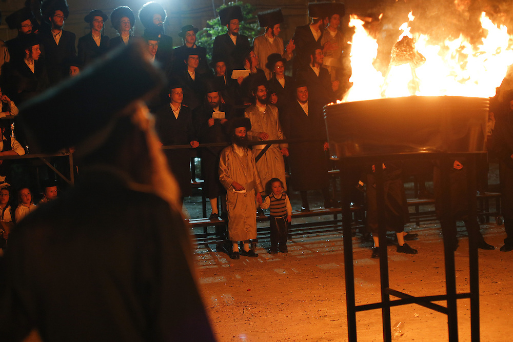 Ultra Orthodox Jews celebrate the Jewish holiday of Lag Baomer by a bonfire in an Ultra orthodox neighborhood in Jerusalem on April 27, 2013.