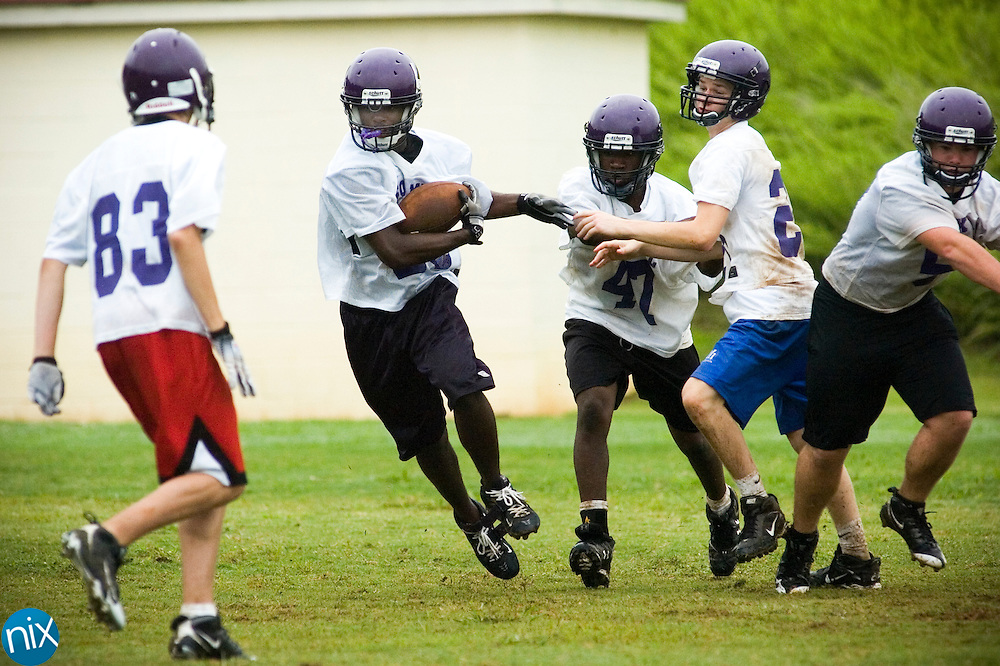 Jhaquille Hankerson carries the ball during Cox Mill High Schools first football practice Saturday morning.
