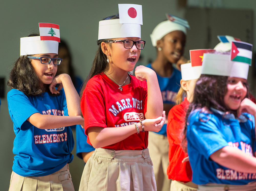 Students perform during a dedication ceremony at Mark White Elementary School, December 13, 2016.