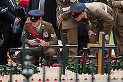 Soldiers use mobile phones to take pictures of their regimental area - The Duke of Edinburgh, Life Member, Royal British Legion, accompanied by Prince Harry, visit the Field of Remembrance at Westminster Abbey  - 10 November 2016, London.