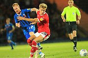 David Perkins and Brad Potts during the EFL Sky Bet League 1 match between Rochdale and Barnsley at Spotland, Rochdale, England on 21 August 2018.