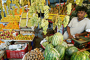 Produce vendor at the Ujjain municipal market. (Supporting image from the project Hungry Planet: What the World Eats.)  Grocery stores, supermarkets, and hyper and megamarkets all have their roots in village market areas where farmers and vendors would converge once or twice a week to sell their produce and goods. In farming communities, just about everyone had something to trade or sell. Small markets are still the lifeblood of communities in the developing world.