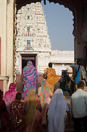 People in colourful saris going into a temple in Pushkar, Rajasthan, India
