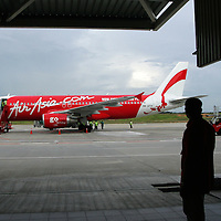 Air Asia carrier arrived at low cost terminal, Sepang ,Malaysia. Air Asia is Asia's leading low fare, no frills airline based in Malaysia. The airline was established in 1993 and started operations on 18 November 1996. .