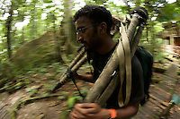Anand Varma carrying gear along the Matapalo trail at the Tiputini Biodiversity Station, Orellana Province, Ecuador