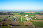 Nederland, Flevoland, Lelystad, 24-10-2013. Vliegveld Lelystad Airport met naast de start- en landingsbaan de testbaan van de Rijksdienst voor het Wegverkeer (RDW).<br /> Lelystad Airport in the polder in between the farmland of the province Flevoland.<br /> luchtfoto (toeslag op standaard tarieven);<br /> aerial photo (additional fee required);<br /> copyright foto/photo Siebe Swart.