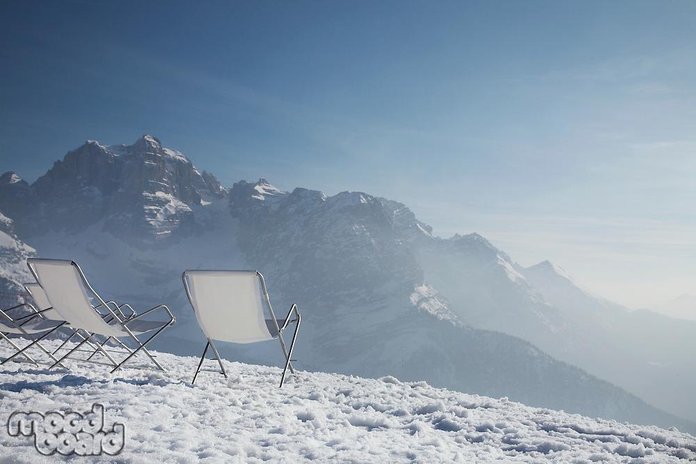 Lawn chairs on mountain peak