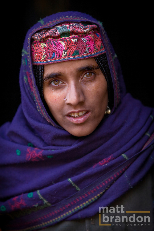 """A Bakarwal Gujjar woman with her traditional embroidered hat, or """"topi"""". Lidderwat, Kashmir, India"""
