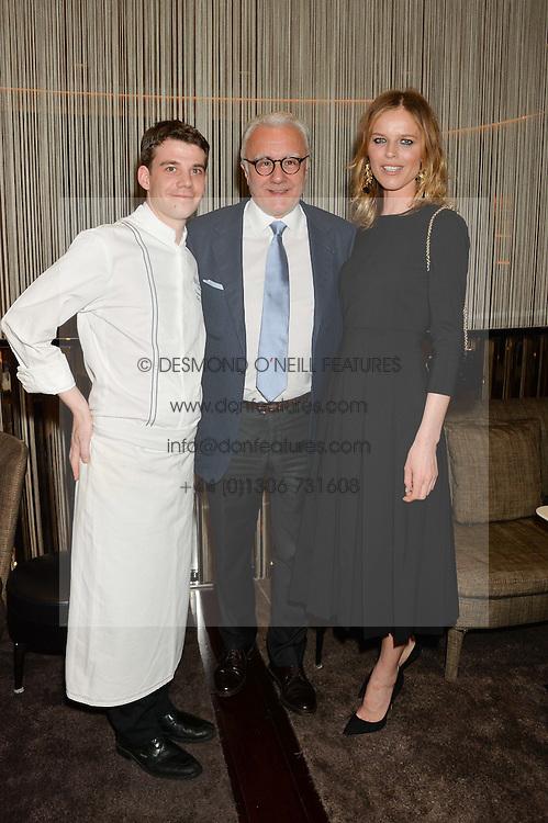 Left to right, DAMIEN LEROUX, ALAIN DUCASSE and EVA HERZIGOVA at the Launch Of Alain Ducasse's Rivea Restaurant At The Bulgari Hotel, 171 Knightsbridge, London on 8th May 2014.