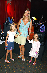 TANIA BRYER and her daughters (L-R) NATASHA & FRANCESCA MOUFFARIGE at a fashion show featuring designs by Diesel Kid's FW05 collection held in The Georgian Restaurant at Harrod's on 1st September 2005.  Proceeds from the event went to the Graet Ormond Street Hospital.<br /><br />NON EXCLUSIVE - WORLD RIGHTS
