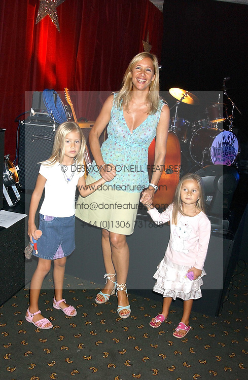 TANIA BRYER and her daughters (L-R) NATASHA &amp; FRANCESCA MOUFFARIGE at a fashion show featuring designs by Diesel Kid's FW05 collection held in The Georgian Restaurant at Harrod's on 1st September 2005.  Proceeds from the event went to the Graet Ormond Street Hospital.<br /><br />NON EXCLUSIVE - WORLD RIGHTS