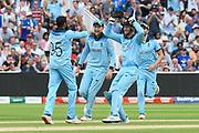 Wicket - Adil Rashid of England celebrates taking the wicket of Pat Cummins of Australia during the ICC Cricket World Cup 2019 semi final match between Australia and England at Edgbaston, Birmingham, United Kingdom on 11 July 2019.