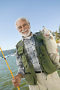 Middle-Aged Man Holding Up Trout