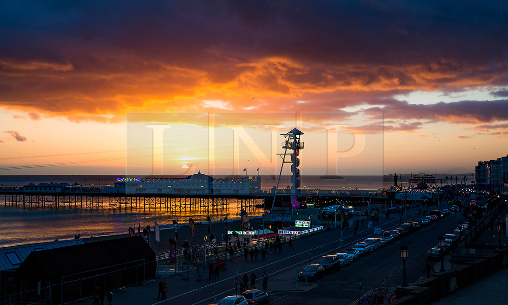© Licensed to London News Pictures. 29/10/2017. Brighton, UK. A golden sun sets behind Brighton Palace pier in Brighton and Hove. Photo credit: Hugo Michiels/LNP