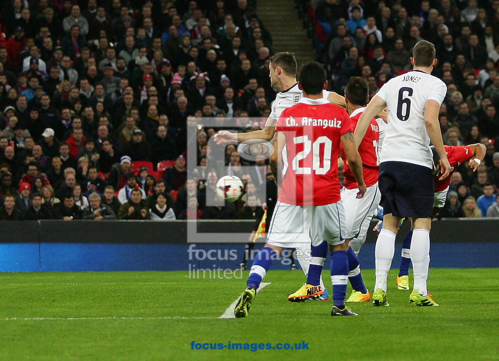 Picture by Rob Fisher/Focus Images Ltd +44 7450 945824<br /> 15/11/2013<br /> Alexis S&aacute;nchez of Chile scores their first goal during the Friendly match at Wembley Stadium, London.
