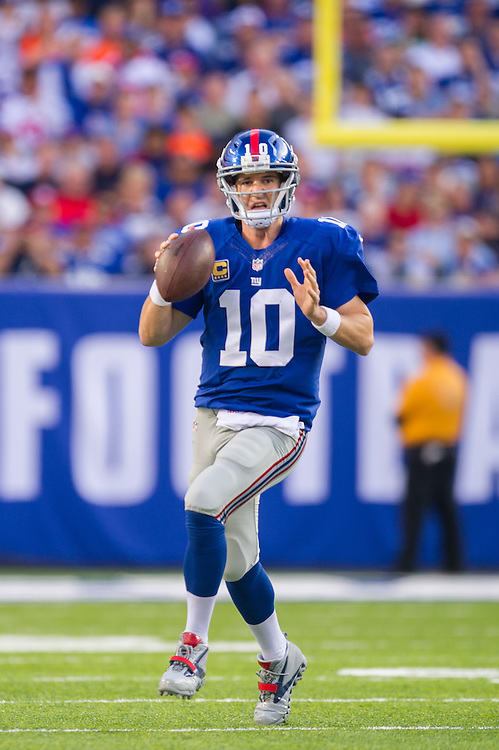 EAST RUTHERFORD, NJ - SEPTEMBER 15: Quarterback Eli Manning #10 of the New York Giants drops back to pass during the game against the Denver Broncos at MetLife Stadium on September 15, 2013 in East Rutherford, New Jersey. (Photo by Rob Tringali) *** Local Caption *** Eli Manning