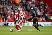 Luke Freeman of Sheffield United holds the ball from Patrick van Aanholt of Crystal Palace during the Premier League match between Sheffield United and Crystal Palace at Bramall Lane, Sheffield, England on 18 August 2019.