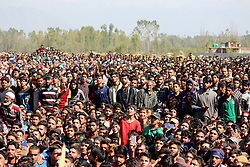 October 14, 2017 - Shopain, Jammu And Kashmir, India - People watching the funeral prayers of Lashkar-e-Toiba commander Wasim Shah alias Usama at Heff area of south Kashmirs Shopian district some 60 kilometers from summer capital of Indian occupied Kashmir. Shah was killed with his comrade Naseer Mir on Saturday in an gunfight with government forces in south Kashmirs Pulwama district (Credit Image: © Aasif Shafi/Pacific Press via ZUMA Wire)
